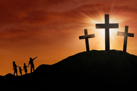 Family is walking toward the Cross on the hill under sunset background photo