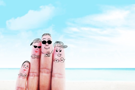 trip travel: Fingers gesturing as family members that travels at the beach Stock Photo