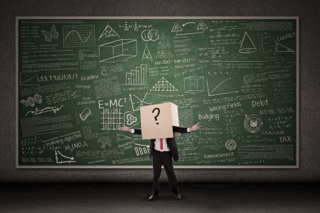 Business person with question mark in front of blackboard Stock Photo - 17824215