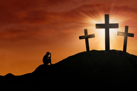 forgiveness: Silhouette of a man repent at the Cross on sunset background