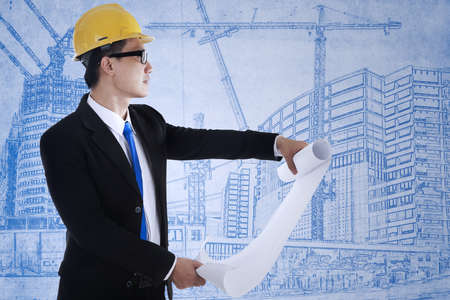 Young architect is reviewing the blueprint plan Stock Photo - 17892878
