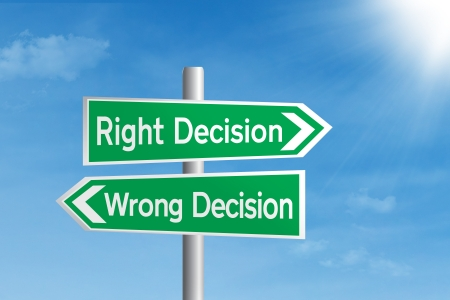 right vs wrong: Road sign of right decision vs wrong decision Stock Photo