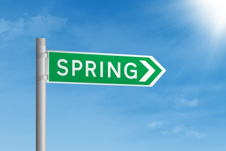 Green road sign with spring writing on it, under blue sky Stock Photo - 17933864