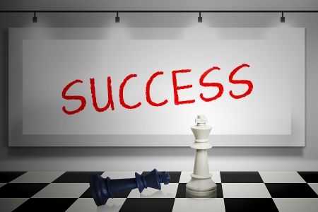 Winning piece of chess game with success writing on whiteboard photo