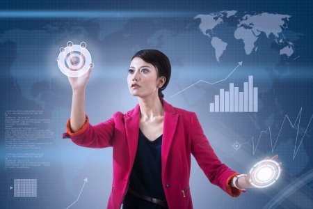 Businesswoman touching futuristic touchscreen on blue world map background photo