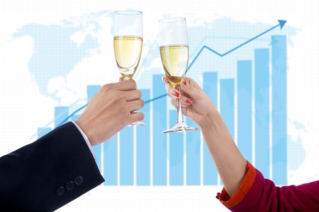 champagne celebration: Two people celebrate success with champagne on profit bar chart background