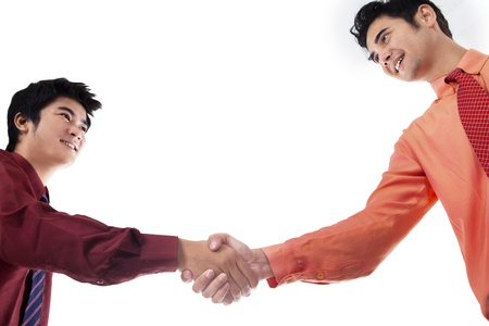 Two business men shaking hands on white background Stock Photo - 18068154