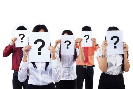 asking question: Business people with question mark on their faces Stock Photo