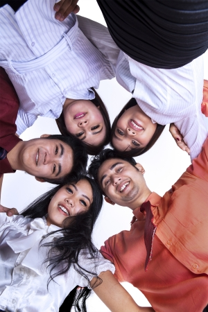 chinese people: Business team joining in a huddle on white background Stock Photo