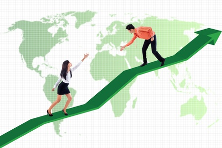 Businessman is helping businesswoman to achieve higher profit on world map background photo