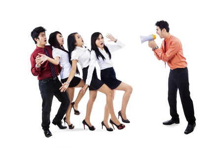 Angry boss shouting with a megaphone to his employees  Isolated over white photo
