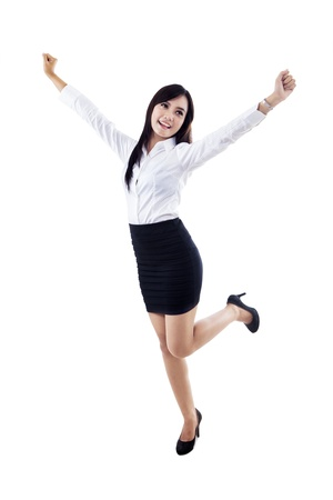 Businesswoman raising her hands in victory on white background photo