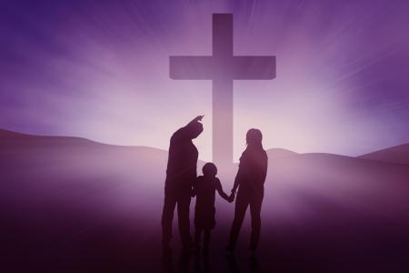 worshipper: Silhouette of Christian family on blue background, horizontal shot Stock Photo