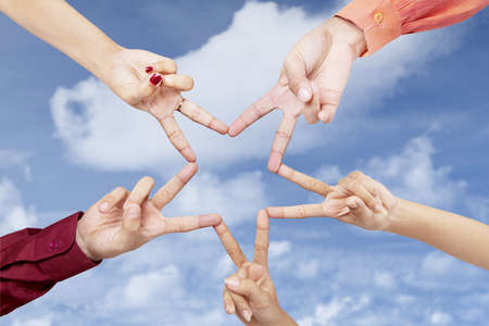 Victory gesture star shape made from human hands Stock Photo - 18173656