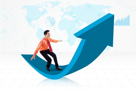 Businessman standing on blue 3D arrow sign on world map background photo
