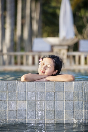 chinesse: Asian woman relaxing at resort Stock Photo