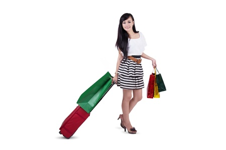 Beautiful woman carry bags and luggage isolated on white Stock Photo - 18339026