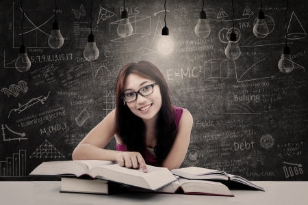 Female student smiling at the camera under lit bulb photo