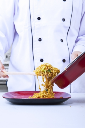 whites: Close-up of chef while preparing noodle Stock Photo