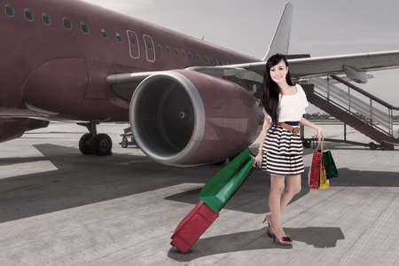 Affluent travel with beautiful woman arriving at airport photo