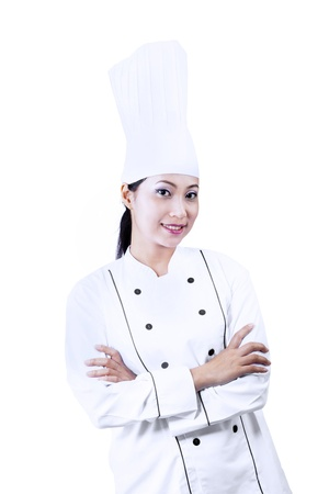Beautiful chef with crossed arms on white background photo