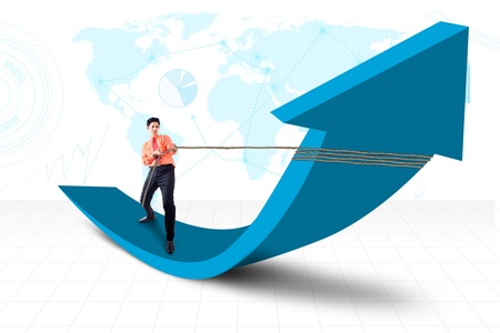 Businessman is pulling arrow sign with world map background at the back photo