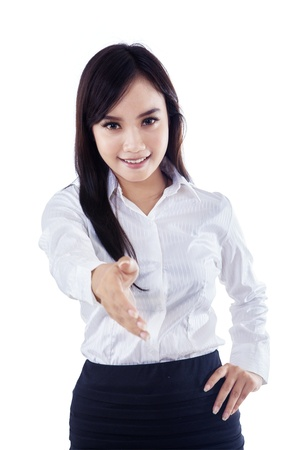 Businesswoman offering a handshake on white background Stock Photo - 18498384