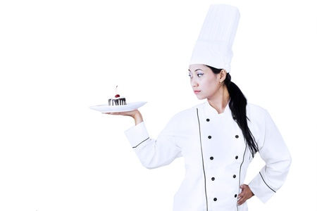 Asian chef is holding chocolate cake dessert on white background photo