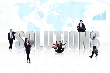 Business people surround the word SOLUTIONS on world map background photo