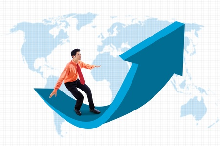 Businessman is standing on up arrow sign with world map background photo