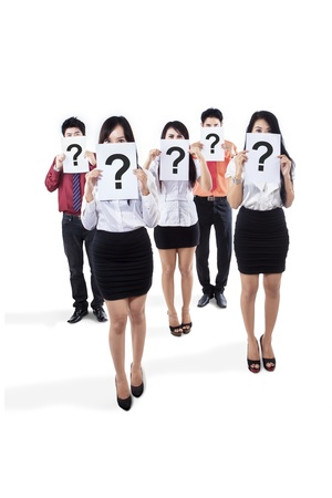 clueless: Businesspeople holding question mark isolated on white background
