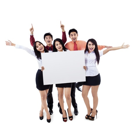 group shot: Successful business team raised hands holding blank billboard Stock Photo