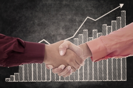 Handshake between two businessmen upon successful transactions photo