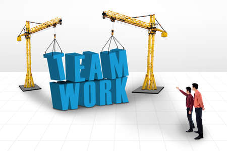 asian business team: Picture of two yellow cranes with the word teamwork and businessmen