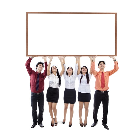 Business people is holding up a copyspace on white background photo