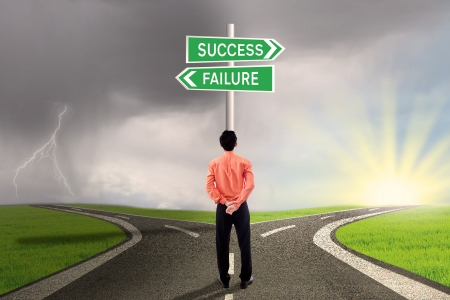 name day: Businessman is choosing success or failure road Stock Photo