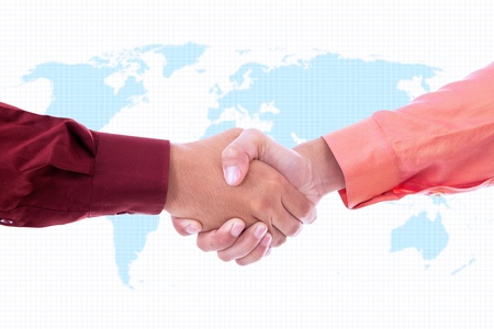 Two businessmen handshaking on world map background Stock Photo - 18676185