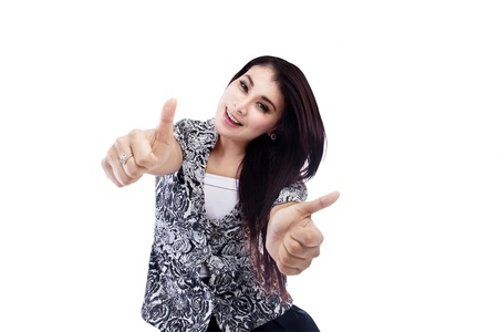 Success businesswoman thumbs up on white background photo