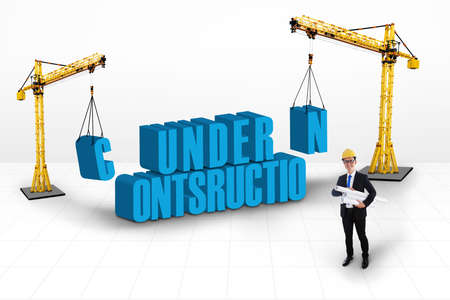 Under construction concept with two yellow cranes at the sides Stock Photo - 18632449
