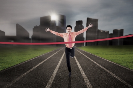 first job: Businessman is finishing the race on city background