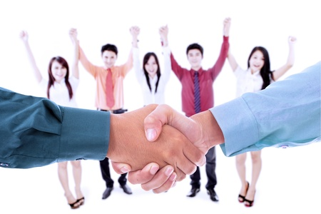 Businessmen handshaking with background of his team, isolated on white photo