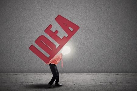 Bright businessman with light bulb head carry word IDEA Stock Photo - 18843996