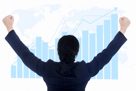 transactions: Businesswoman raised her arms due to winning investment Stock Photo