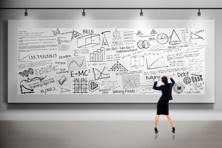 business attire teacher: Businesswoman is holding her head in front of white billboard