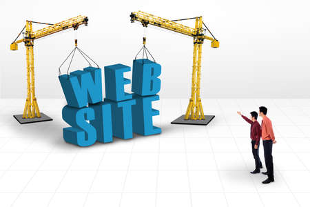 Business manager is pointing at website building and yellow cranes on white background photo