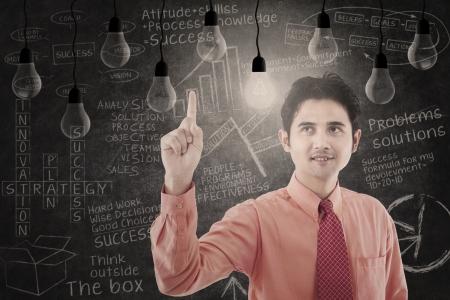 Businessman has bright idea on light bulbs background Stock Photo - 18936765