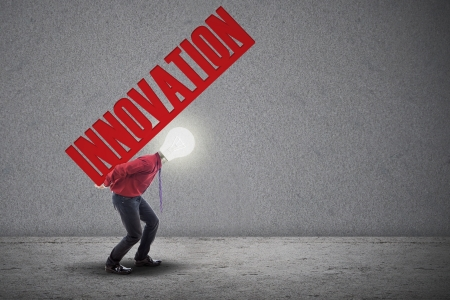 Light bulb head is carrying the word innovation  Stock Photo - 18936764
