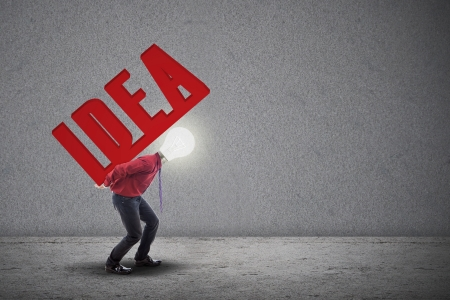 initiative: Light bulb head is carrying the word IDEA at his back on grey background
