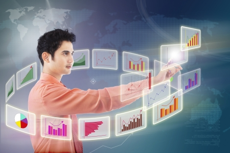 touching hands: Businessman choosing graph on touchscreen background