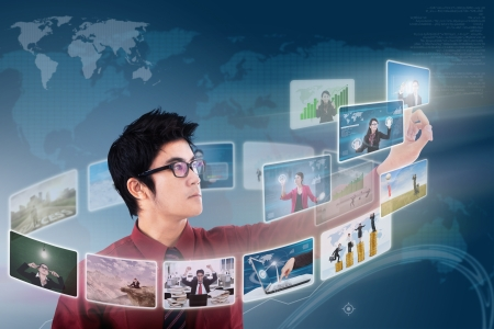 Businessman choosing on photo via digital touchscreen with world map background Stock Photo - 18960877
